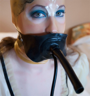 Anna Rose in the Inflatable Rubber Gag with breath tube