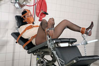 Straitjacket, Muzzle and Belts on Gyno Chair